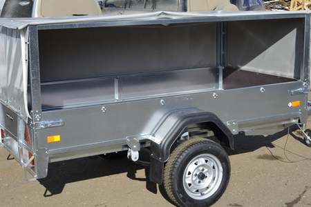 Автомобильный прицеп ССТ- 7132-02 К с тентом