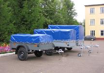 Автомобильный прицеп САЗ-82994 с тентом